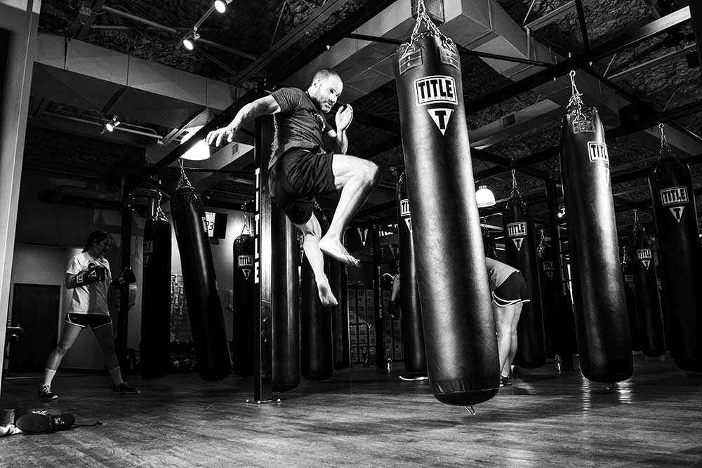 MMA fighter working out in an mma gym.