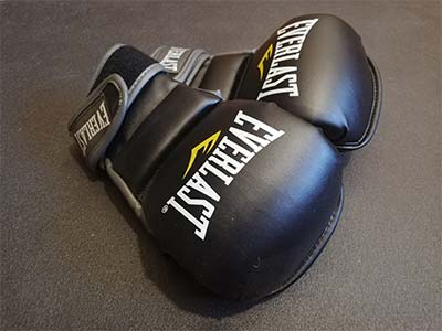MMA gloves lying on the gym mat.