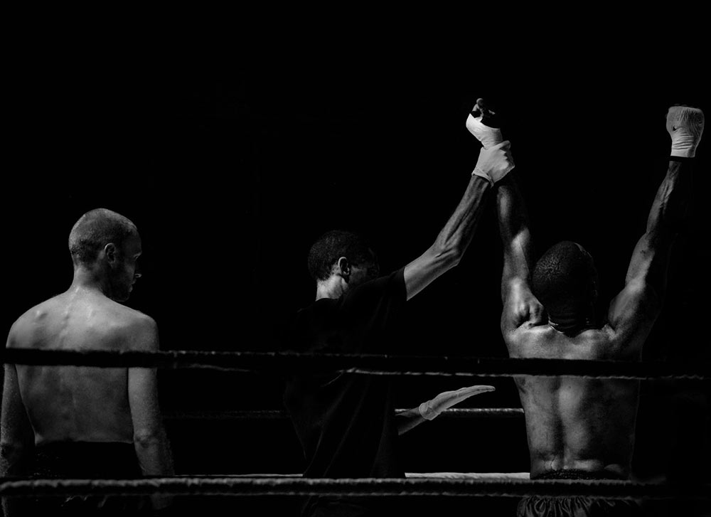 Two boxers in a boxing ring after fight.