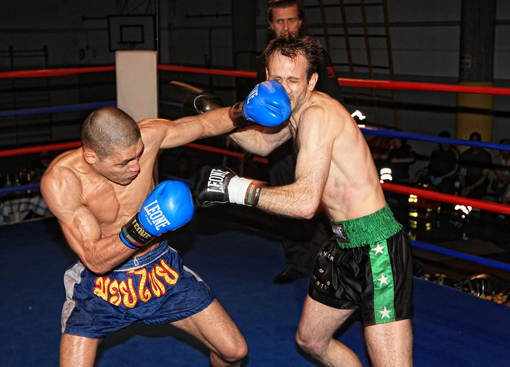 Two kickboxers fighting in the ring.