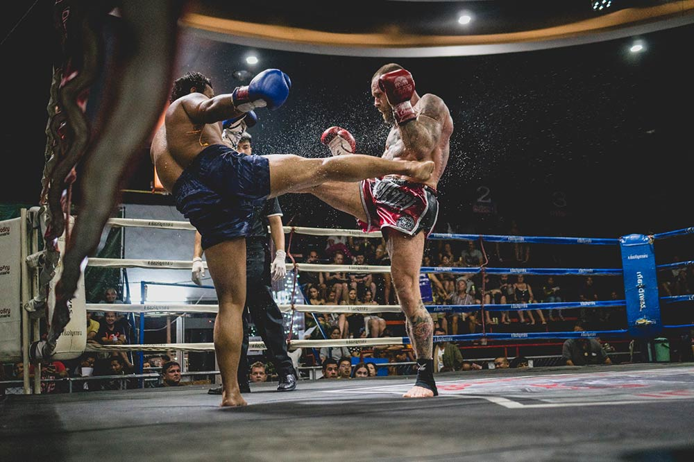Muay Thai fighters inside a ring Thailand.